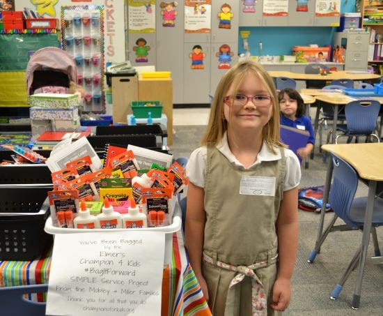Hailey and our #Elmer's Glue Bag It Forward donation to her teacher.