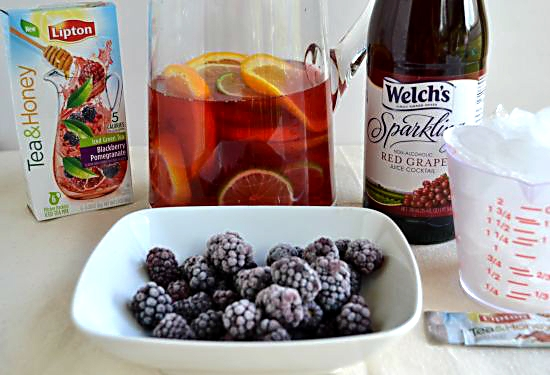 Frozen Blackberries, Sparkling Grape Juice and ice cubes for Sangria Mocktail